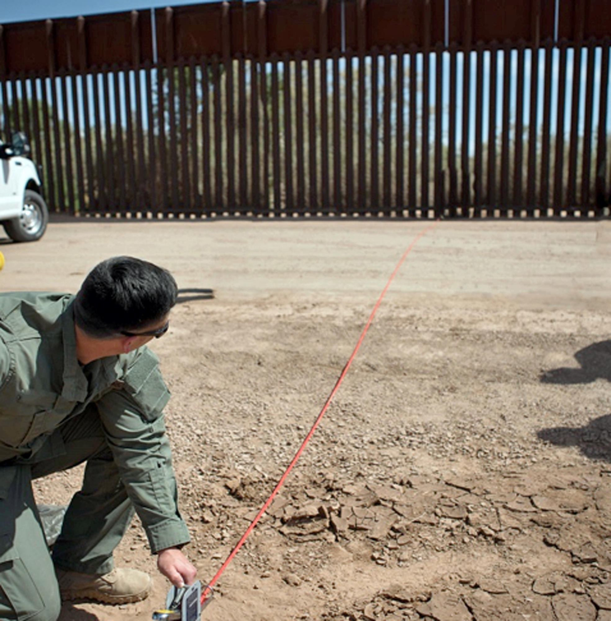 A Border Patrol agent shows the path of a tunnel that crosses the U.S.-Mexico border near Calexico. The passage extends about 60 feet into Mexico and at least 80 feet into the United States.