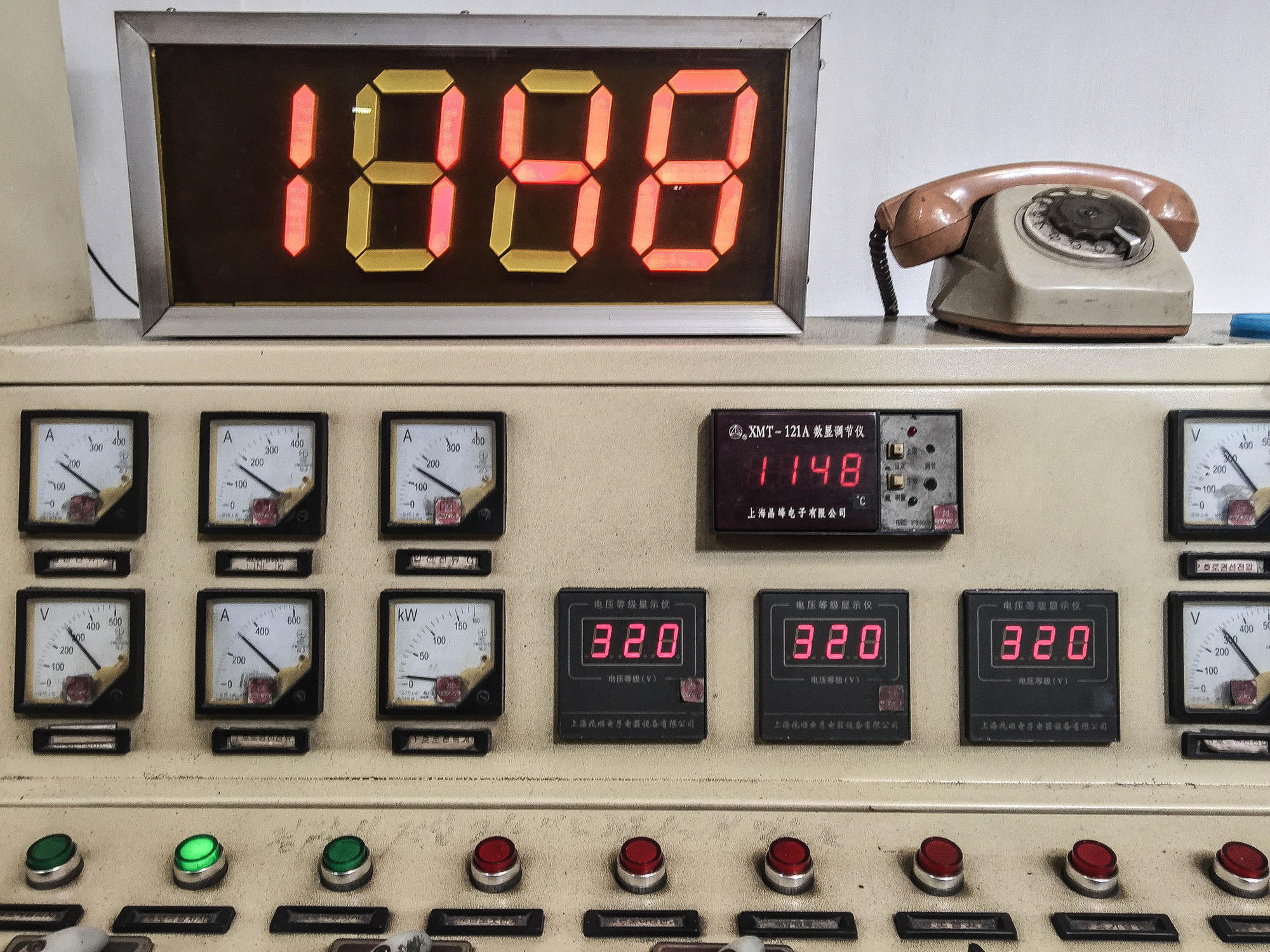 A control panel on a machine inside the factory.