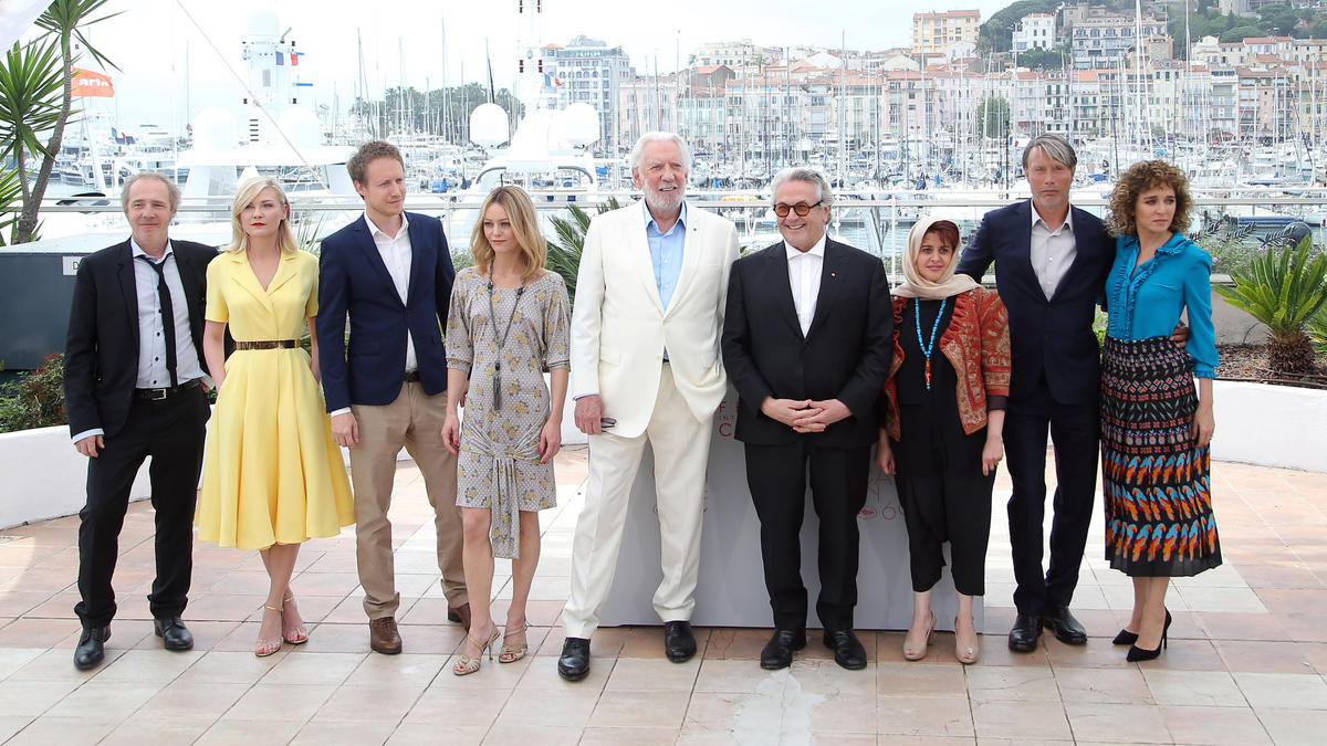 George Miller, president of the Cannes Film Festival jury, fourth from right, poses with jury members, from left, Arnaud Desplechin, Kirsten Dunst, Laszio Nemes, Vanessa Paradis, Donald Sutherland, Katayoon Shahabi, Mads Mikkelsen and Valeria Golino. (Thibault Camus / Associated Press)