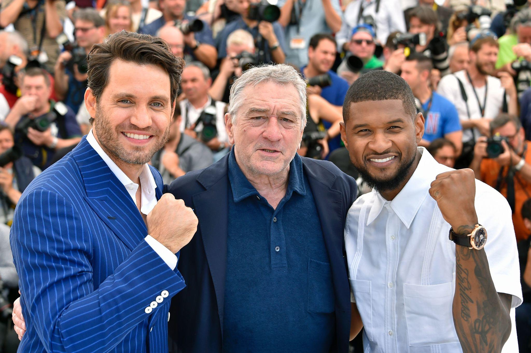 "Edgar Ramirez, left, Robert de Niro and Usher Raymond IV at the ""Hands of Stone"" photocall at the Cannes Film Festival. (Loic Venance / AFP/Getty Images)"