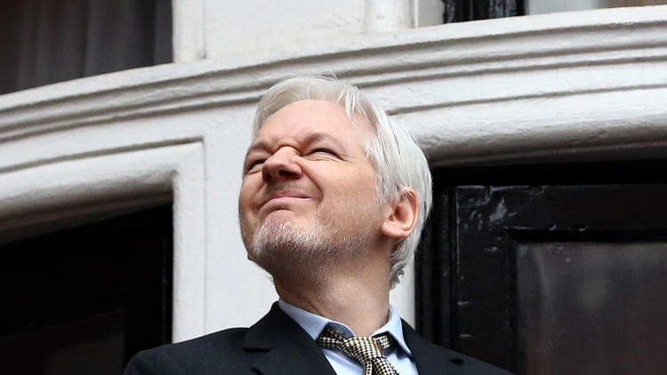 Wikileaks founder Julian Assange squints in the sunlight as he prepares to speak from the balcony of the Ecuador Embassy in London in February. (Carl Court / Getty Images)