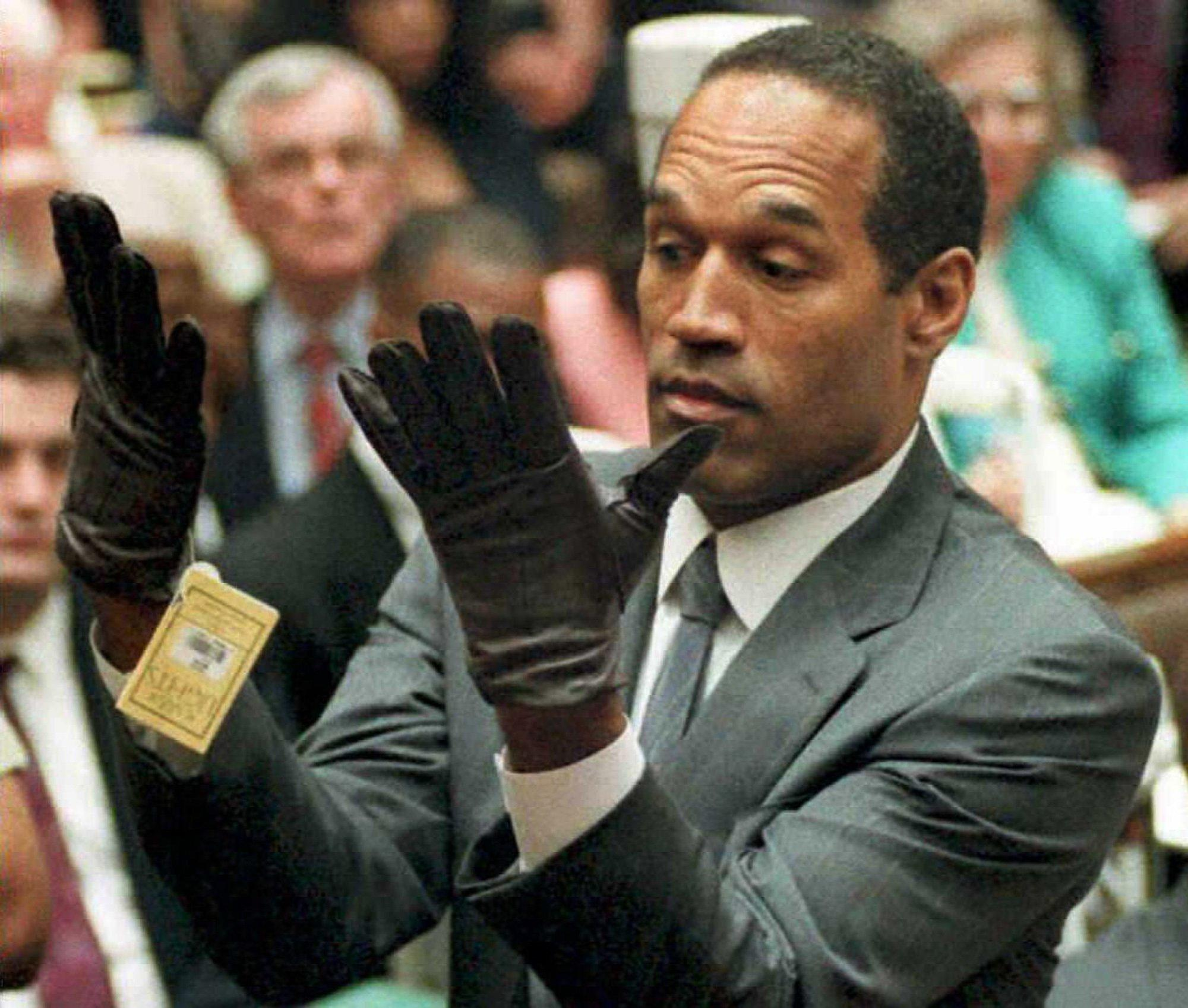 The pivotal moment in the 1995 O.J. Simpson murder trial was when the defendant put on a pair of gloves similar to the bloody ones found at the crime scene.