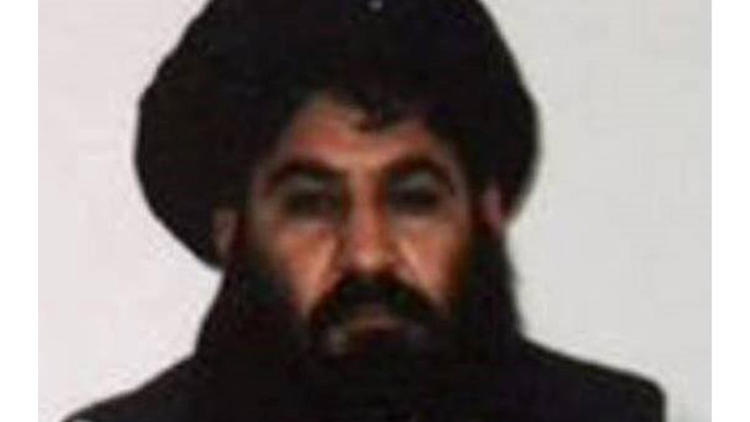 Mansour in an image released by the militant group in December 2015.
