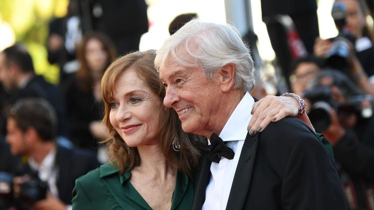 "French actress Isabelle Huppert and Dutch director Paul Verhoeven arrive for the screening of ""Elle"" at Cannes. (Anne-Christine Poujoulat / AFP/Getty Images)"