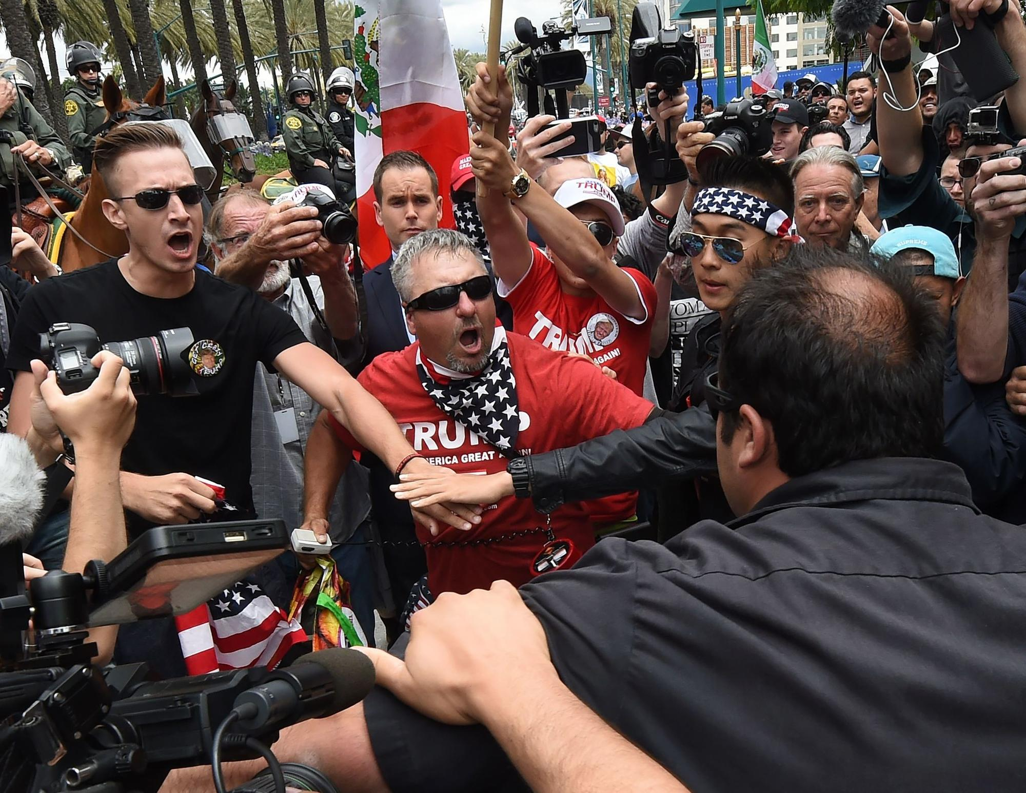 Anti-Trump protesters clash with Trump supporters outside the Anaheim Convention Center during a rally on May 25.