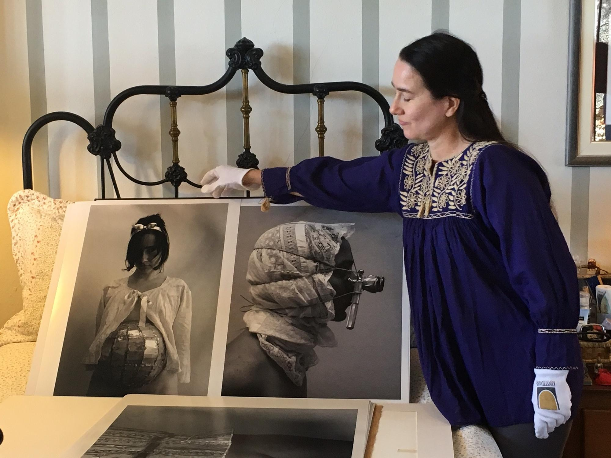 Artist Cirenaica Moreira displays her photographs at her home in Cojimar, Cuba.
