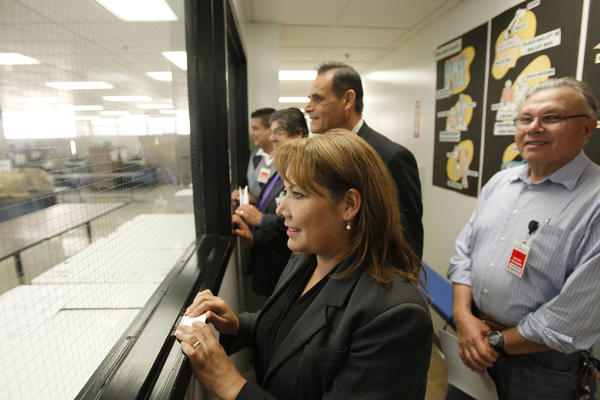 Patty Lopez, left, watches as ballots are counted in her 2014 race against then-incumbent Raul Bocanegra, who she bested by less than 500 votes.