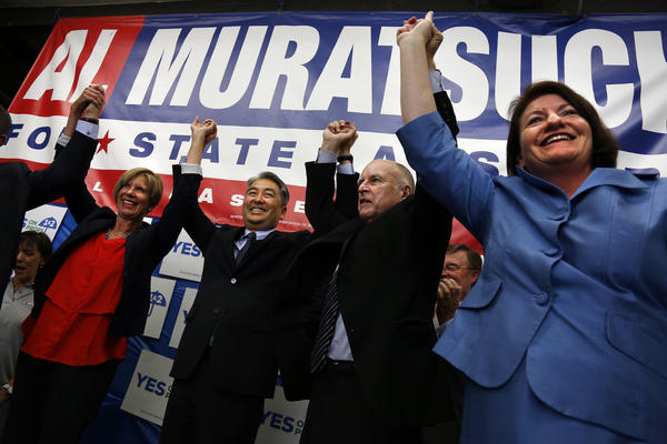 Former Assemblyman Al Muratsuchi, second to left, lost his seat to a Republican challenger in 2014 despite the backing of Democratic leaders and Gov. Jerry Brown.
