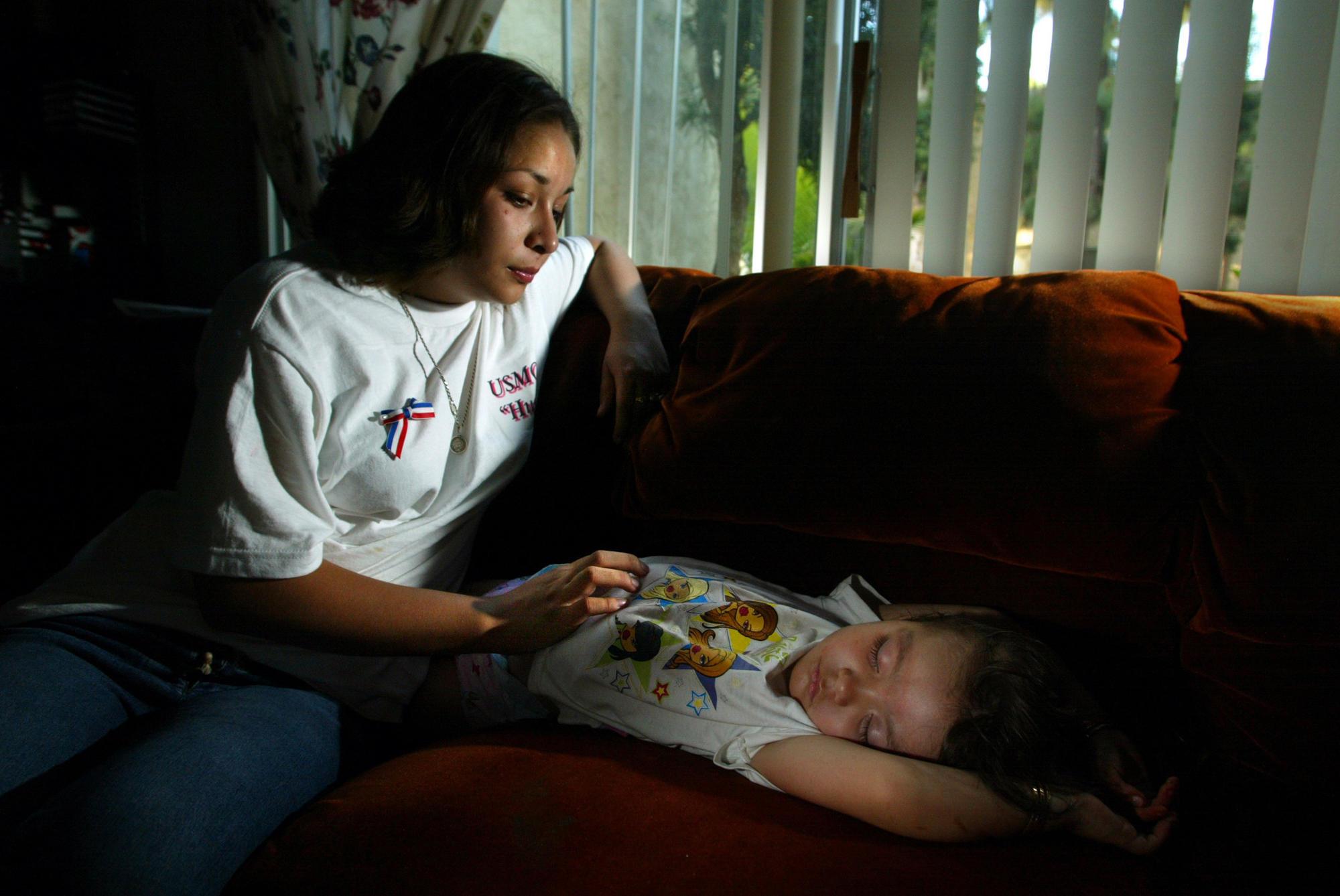Ivonne Gonzalez, 18, widow of Jesus Gonzalez, in her Escondido apartment with their daughter Delilah, 2.