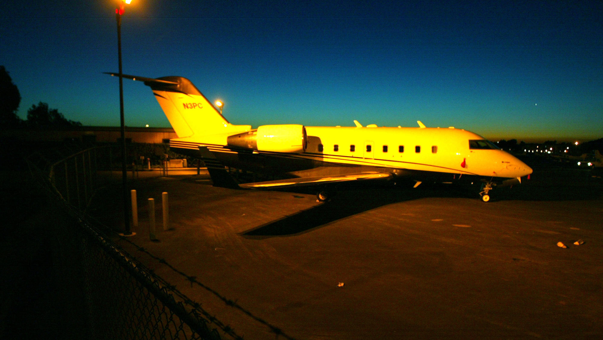 Sitting in the yellow glow of an industrial light in the corner of John Wayne Airport off Campus Avenue, and clearly visible to the public is a private jet believed to be owned by the Trinity Broadcasting Network