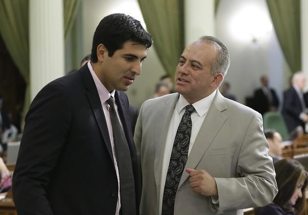 Raul Bocanegra, right, in a 2014 file photo when he was a member of the California Assembly.