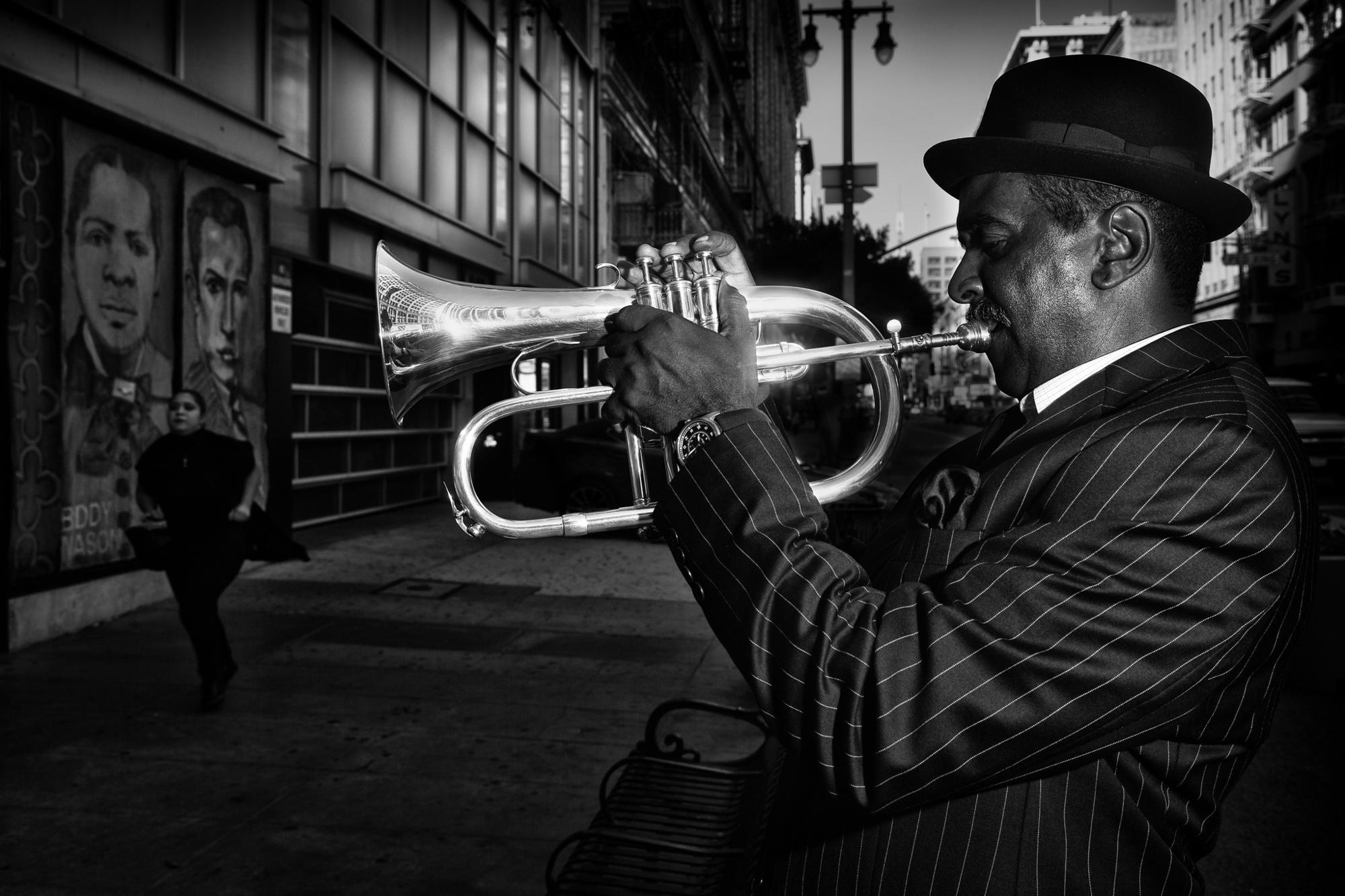 Billy Coates playing jazz near 9th and Broadway, as a woman runs to catch her bus.