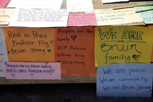 Condolence notes for the engineering professor who was shot and killed on Wednesday are left at the foot of UCLA's Bruin Bear statue. (Nick Ut / Associated Press)