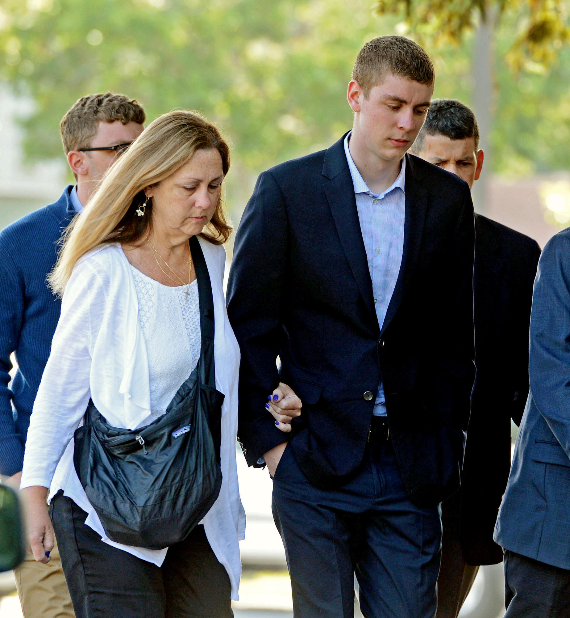 Brock Turner, right, makes his way into the Santa Clara County Superior Courthouse in Palo Alto.