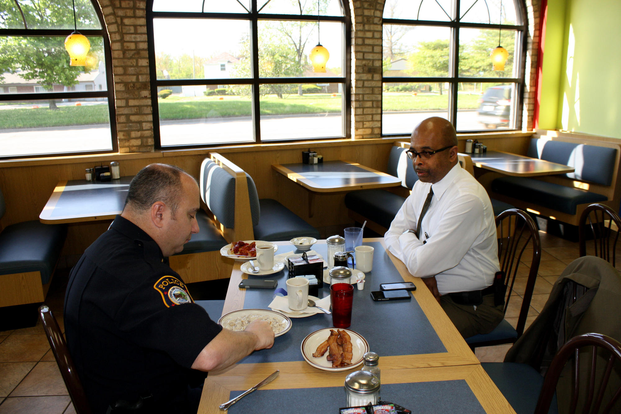 Riley eats at Applewood Coney Island, a local diner, with Lt. Jeff Twardzik, who oversees patrol operations in Inkster.
