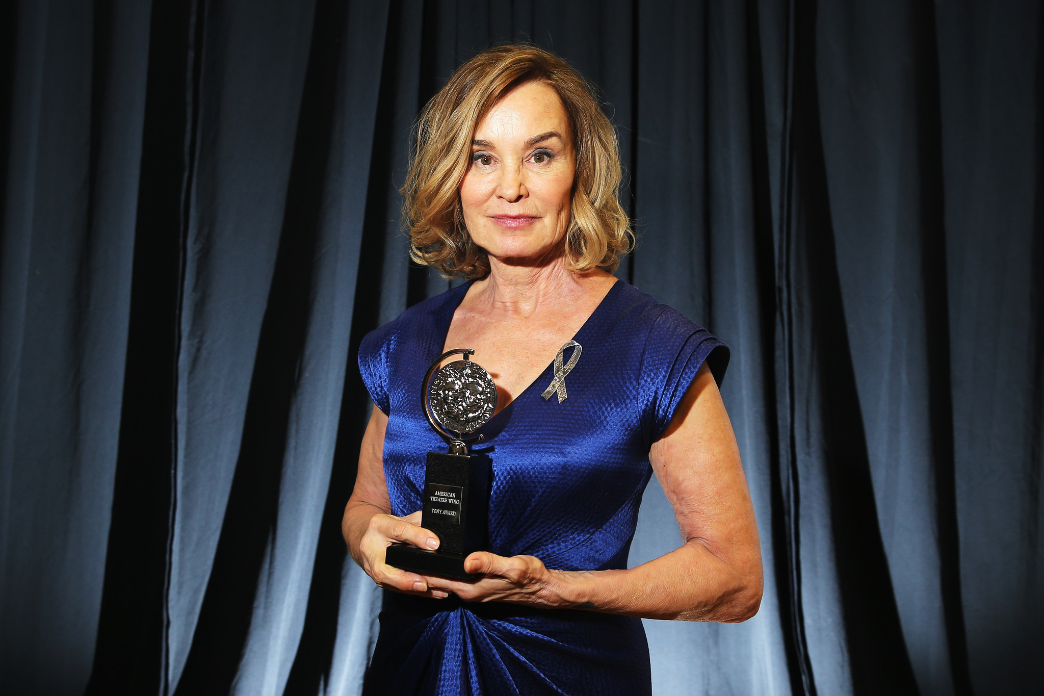 Jessica Lange is shown with her Tony at the Beacon Theatre. (Jemal Countess / Getty Images for Tony Awards)