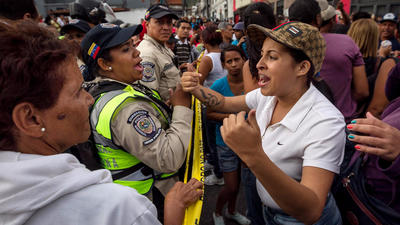 Looting and unrest continue roiling Venezuela as shortages persist and protesters demand food
