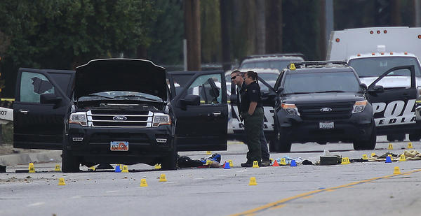 Crime scene investigators search Syed Rizwan Farook and Tashfeen Malik's SUV after a gun battle with the couple in San Bernardino on Dec. 4, 2015. (Allen J. Schaben / Los Angeles Times)