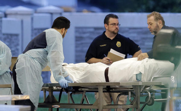 The body of one of the Orlando massacre victims arrives at the Orange County, Fla., medical examiner's office on June 12, 2016. (Alan Diaz / Associated Press)