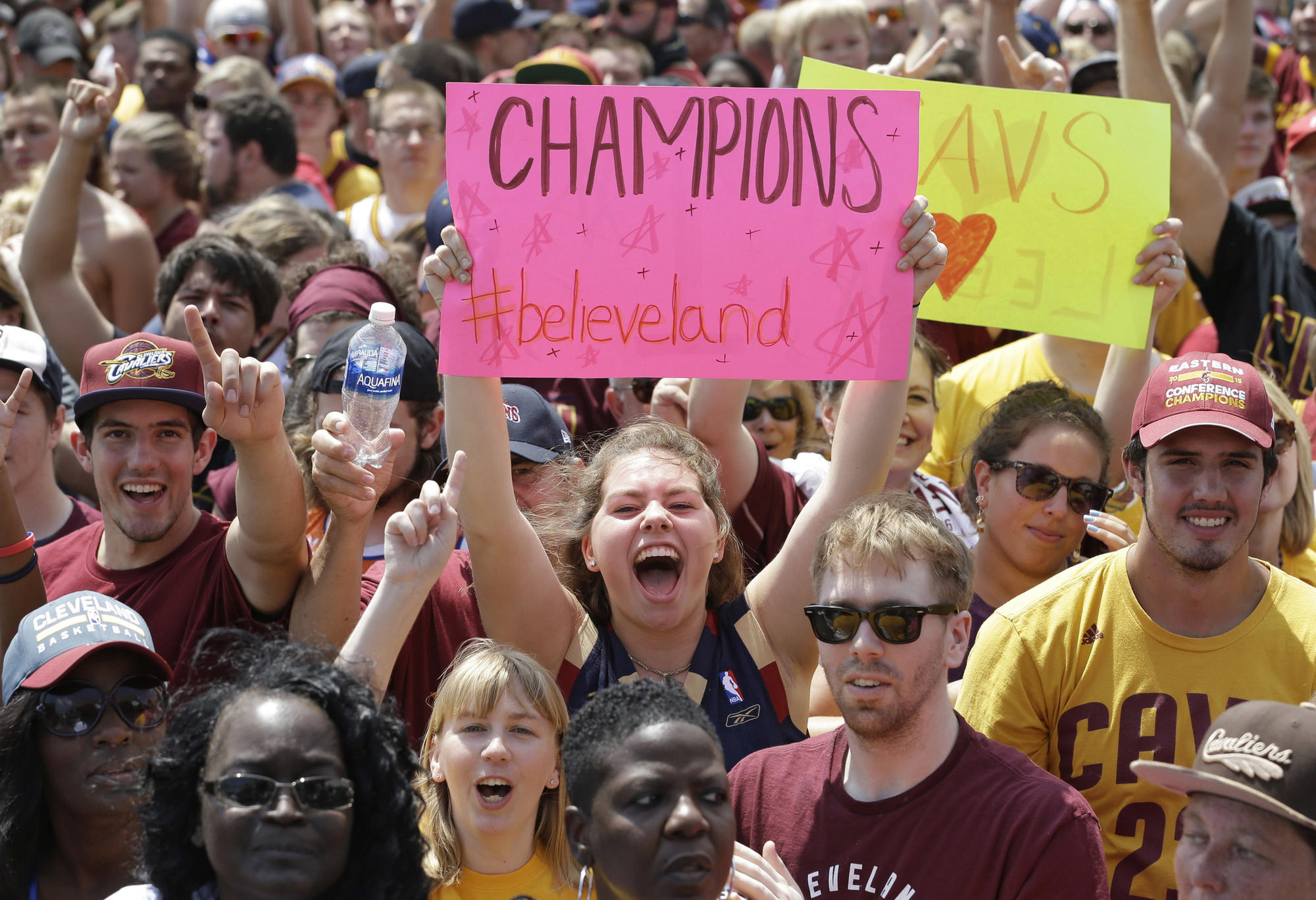 Cleveland Cavaliers fans cheer as they wait for the team's return on Monday.