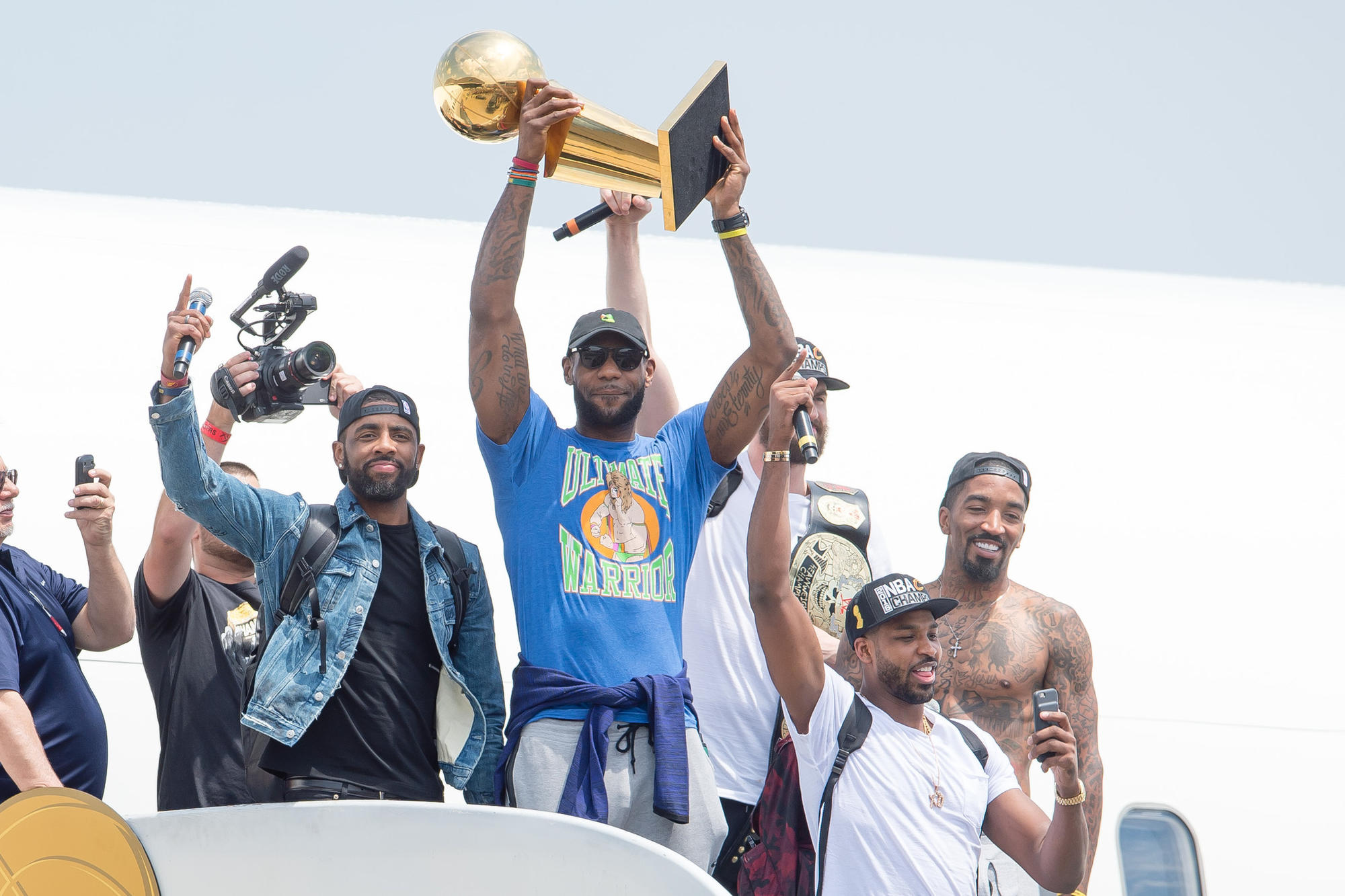 LeBron James with teammates Kyrie Irving, left, Tristan Thompson, Kevin Love and J.R. Smith as they emerge from the plane in Cleveland.