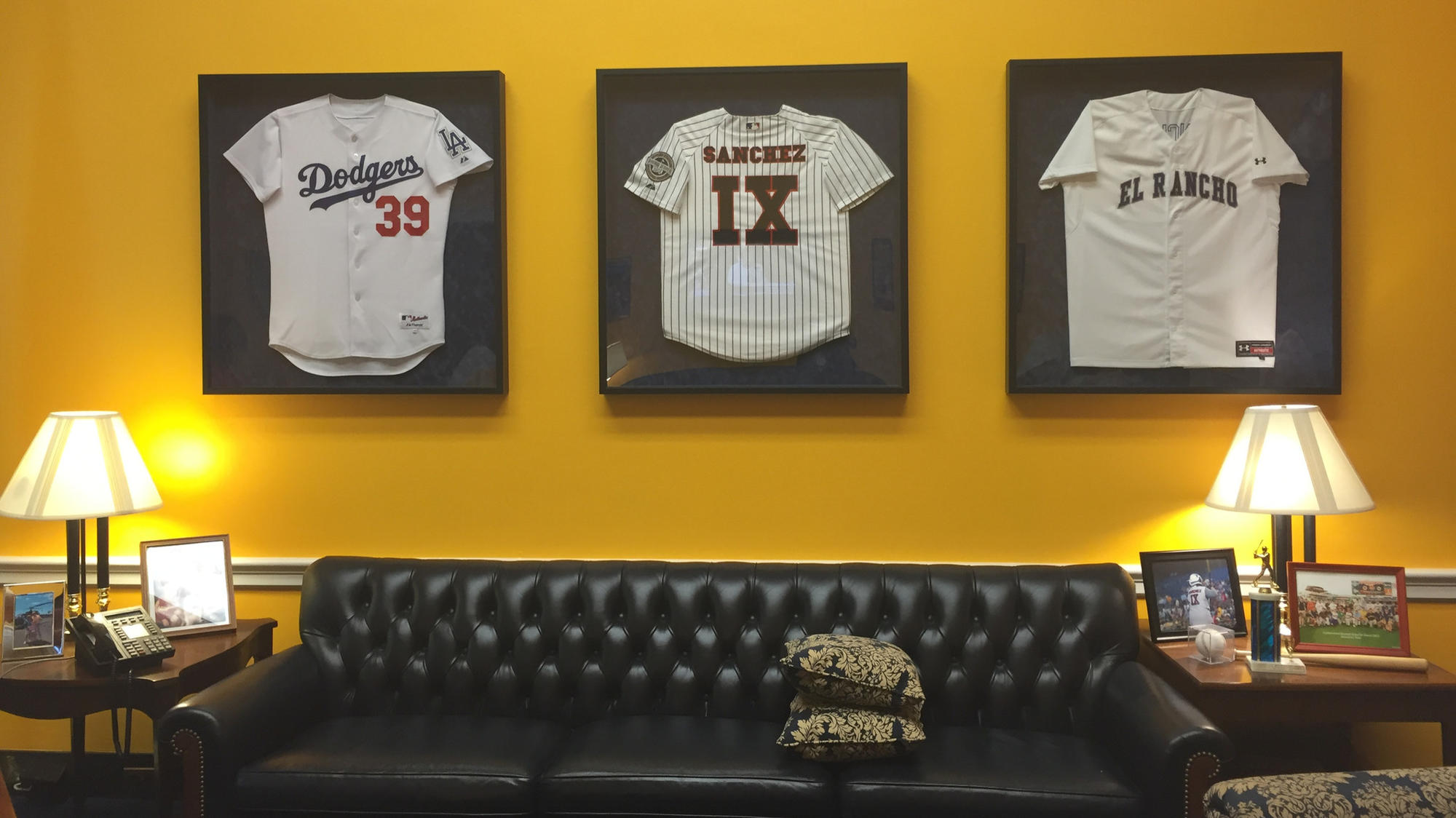 Some of Linda Sanchez's jerseys hang on her office wall.