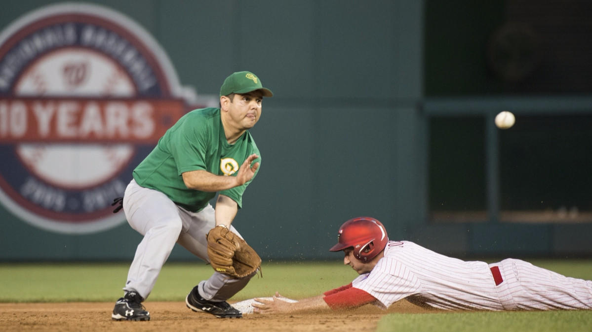 Rep. Raul Ruiz (D-Palm Desert) waits for a late throw as Rep. Ryan Costello (R-Pa.) slides safely at second base during the 54th Annual Roll Call Congressional Baseball Game.