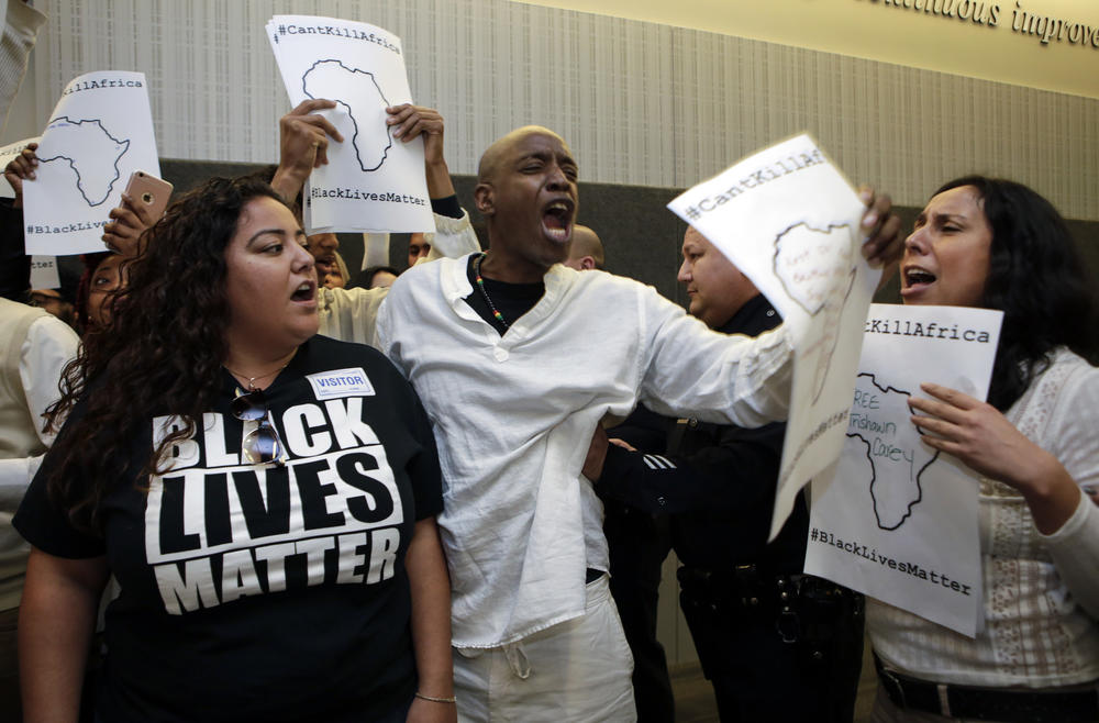 Black Lives Matter protestors disrupt a Los Angeles Board of Police Commissioners meeting in March.
