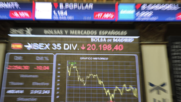 Stock exchange boards in Madrid show a sharp drop Friday after Britain's vote to leave the European Union. (Curto de la Torre / AFP/Getty Images)