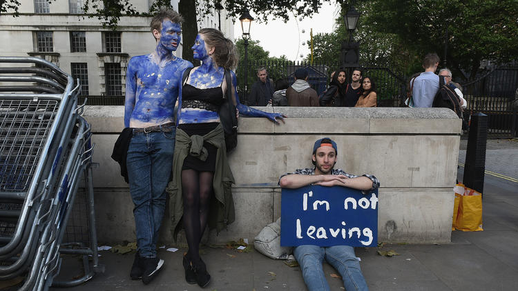 A young couple painted as EU flags protest outside Downing Street in London. They opposed Britain's decision to leave the EU. (Mary Turner / Getty Images)