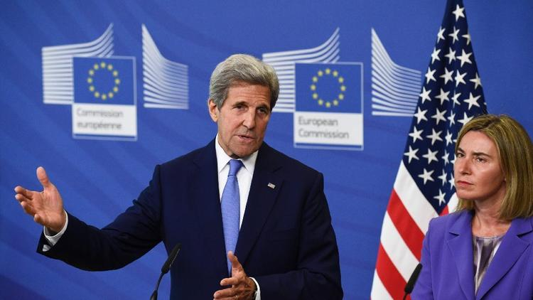 Secretary of State John F. Kerry and Federica Mogherini, the EU high representative for foreign affairs and security policy, speak to reporters Monday in Brussels. (AFP/Getty Images)