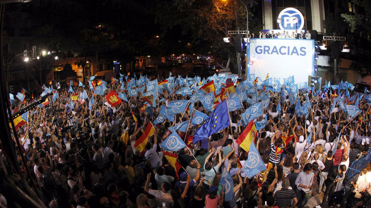 Spanish acting Prime Minister Mariano Rajoy addresses supporters from Popular Party headquarters in Madrid after general elections results were announced Sunday. (Javier Lizon / European Pressphoto Agency)