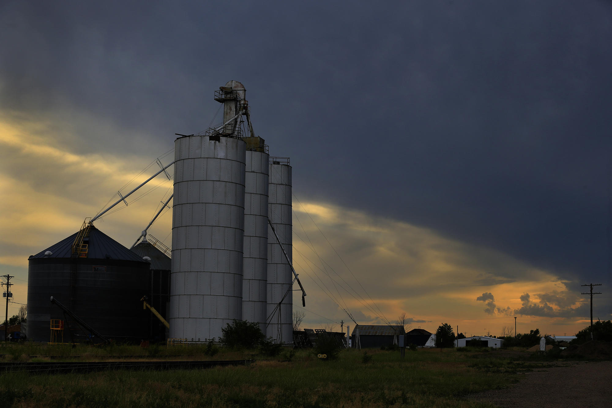 A grain elevator stands tall at sunset in Eads, Colo.