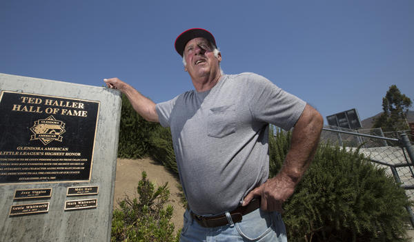 Ted Haller stands next to Glendora's Little League Hall of Fame, which is named after him.