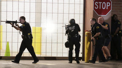 Dallas police respond after shots were fired during a protest over recent fatal shootings in Baton Rouge, La., and Minnesota. (Maria R. Olivas / Dallas Morning News)