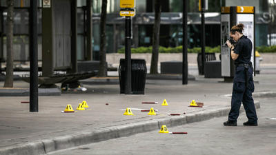 Investigators document the crime scene in Dallas, where a sniper killed five police officers and wounded seven others. (Marcus Yam / Los Angeles Times)