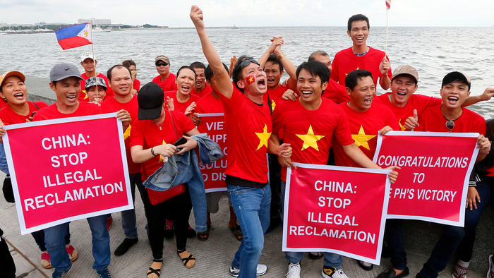 Vietnamese expatriates cheer at a rally by Manila's baywalk before the U.N. international tribunal announced its ruling on the South China Sea on Tuesday. The Vietnamese are supporting the Philippines' case.