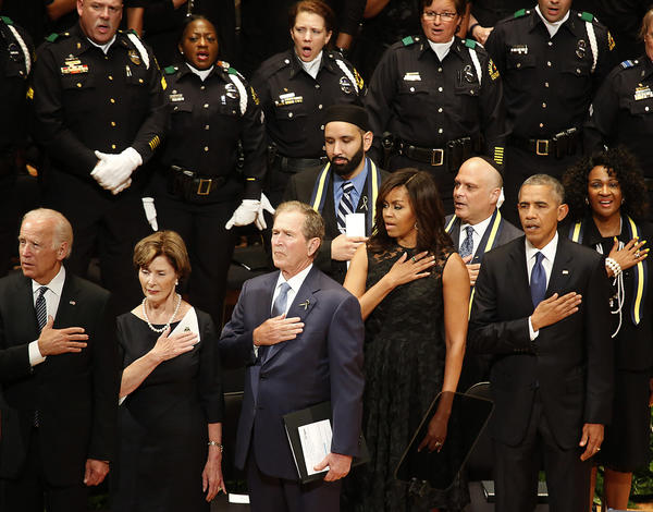 President Obama attends a memorial service for five slain Dallas police officers with Vice President Joe Biden, Laura and George W. Bush and First Lady Michelle Obama at the Morton H. Meyerson Symphony Center. (Barbara Davidson / Los Angeles Times)