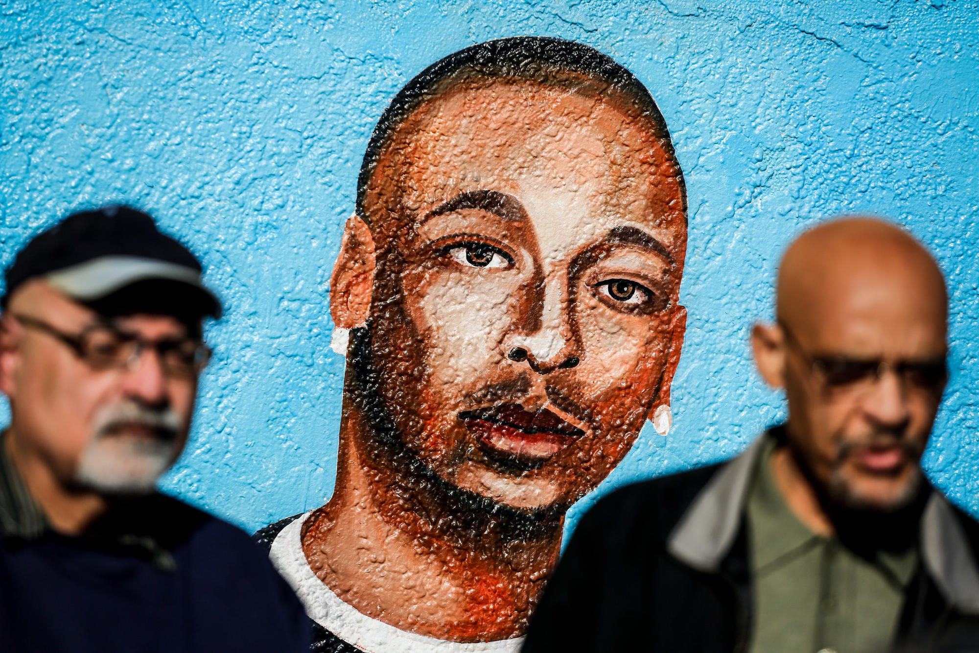 At the corner of 65th Street and Broadway in South Los Angeles, the site of the LAPD's fatal shooting of Ezell Ford is memorialized on a wall.