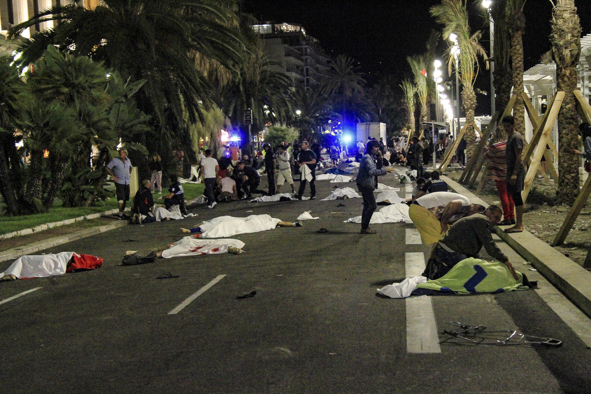 Bodies lie on the street after a truck plowed through a crowded seaside promenade in Nice, France.