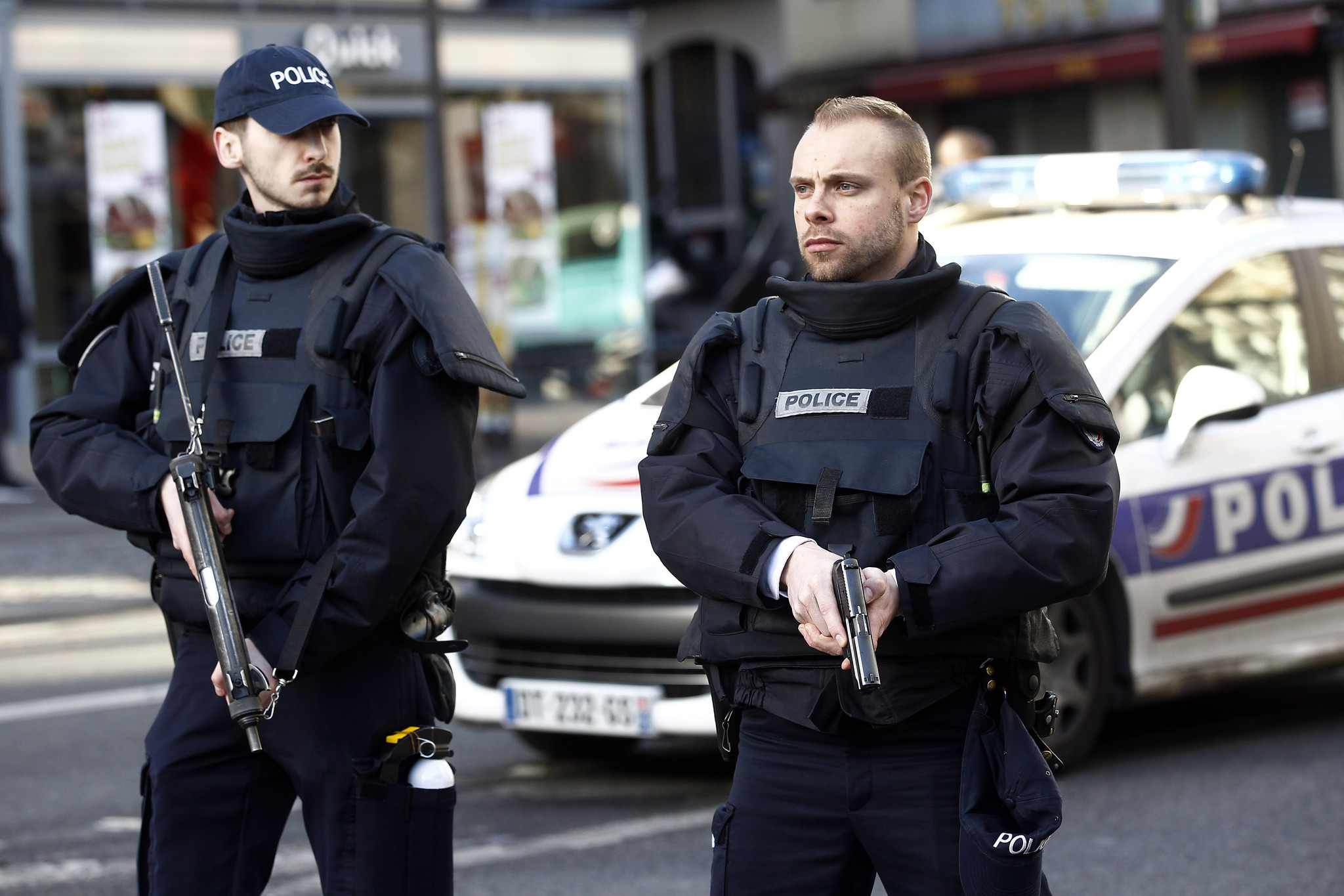 Armed French police patrol near the Boulevard de Barbes after an attack on a Paris police station.