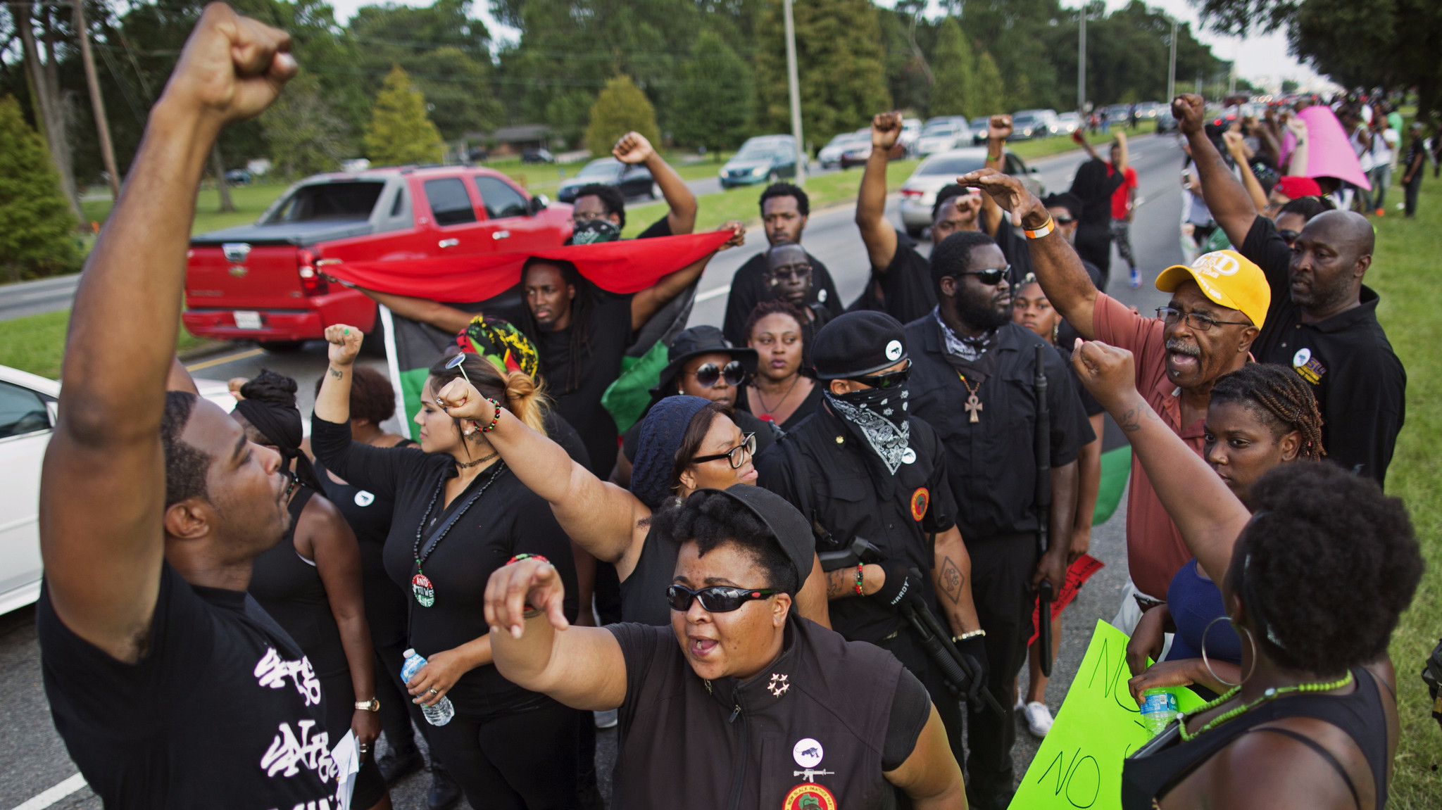 Members of the New Black Panther Party march in Louisiana following the death there of Alton Sterling.