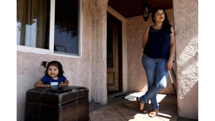 Adela Jimenez, 38, mother of six children, shown with daughter Esmeralda Jimenez, 20-months, had contaminants removed from the soil surrounding her home in February.