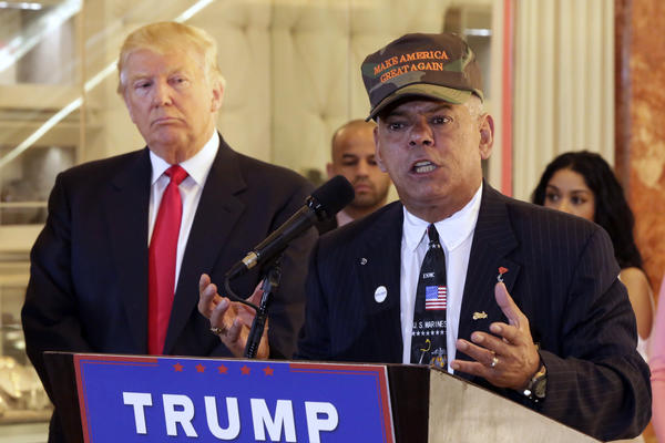 "Al Baldasaro, right, a New Hampshire state representative who appeared often at Donald Trump events this year, told a radio interviewer Wednesday that ""Hillary Clinton should be put in the firing line and shot for treason."" (Richard Drew / Associated Press)"