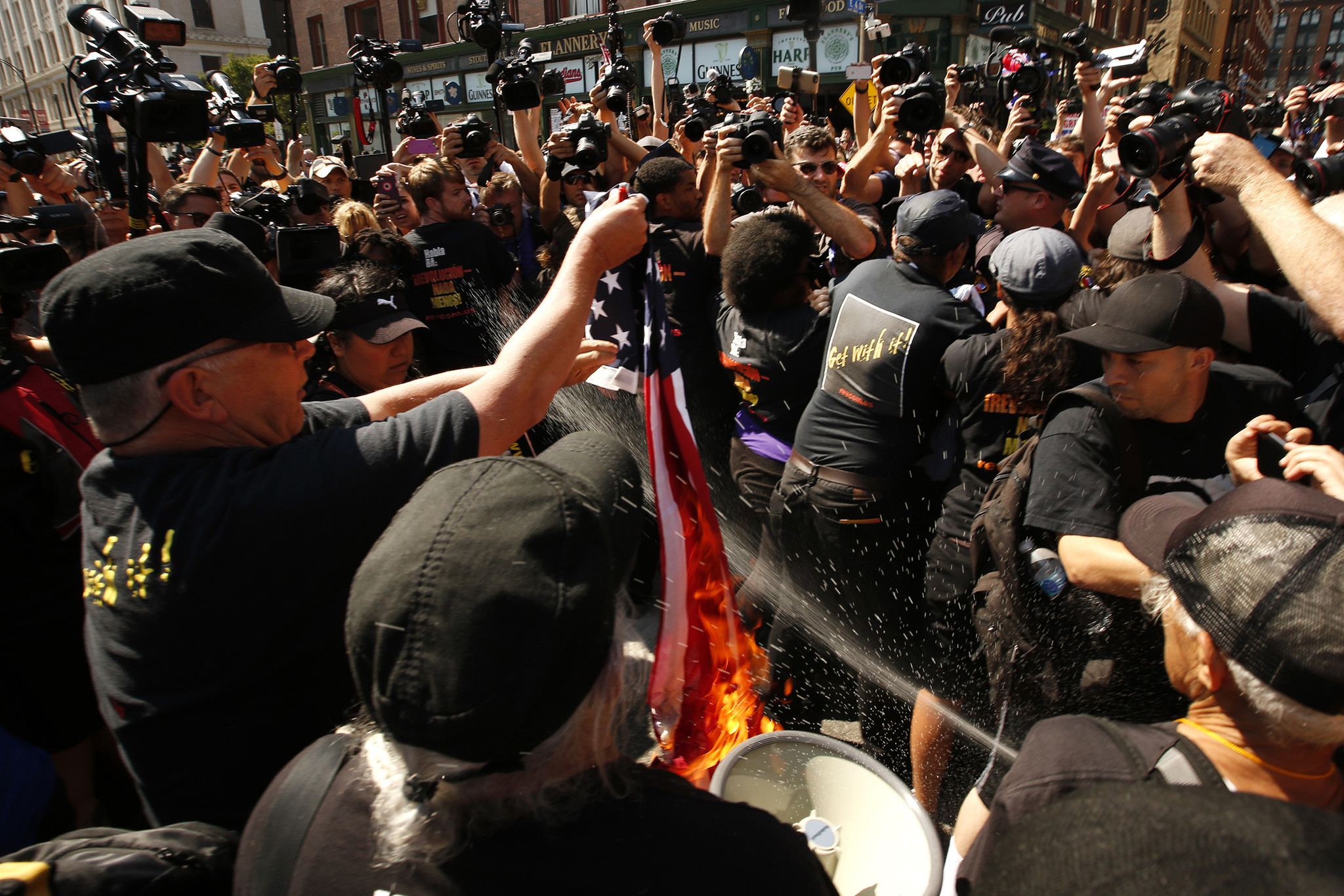 Police arrest protesters from the Revolutionary Communist Party as they burned an American flag.