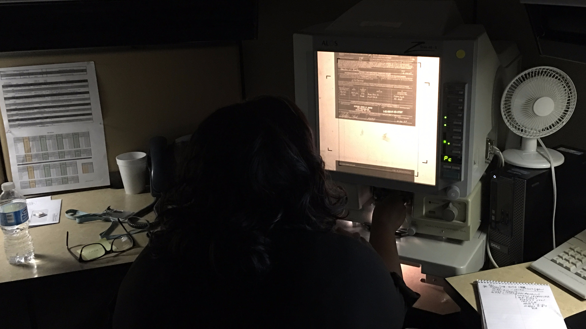 An analyst reviews firearms records on microfilm at the Bureau of Alcohol, Tobacco, Firearms and Explosives' National Tracing Center.