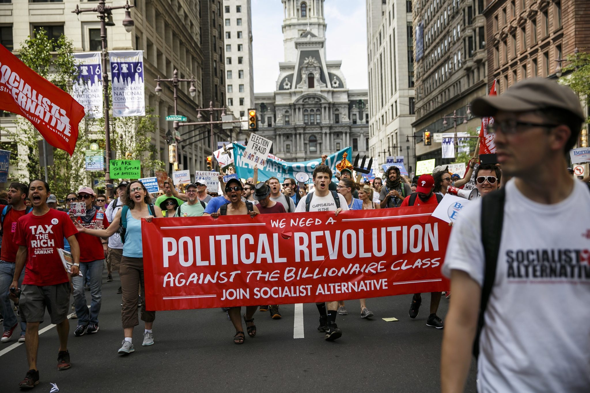 Bernie Sanders supporters march down Broad Street in Philadelphia on Sunday.
