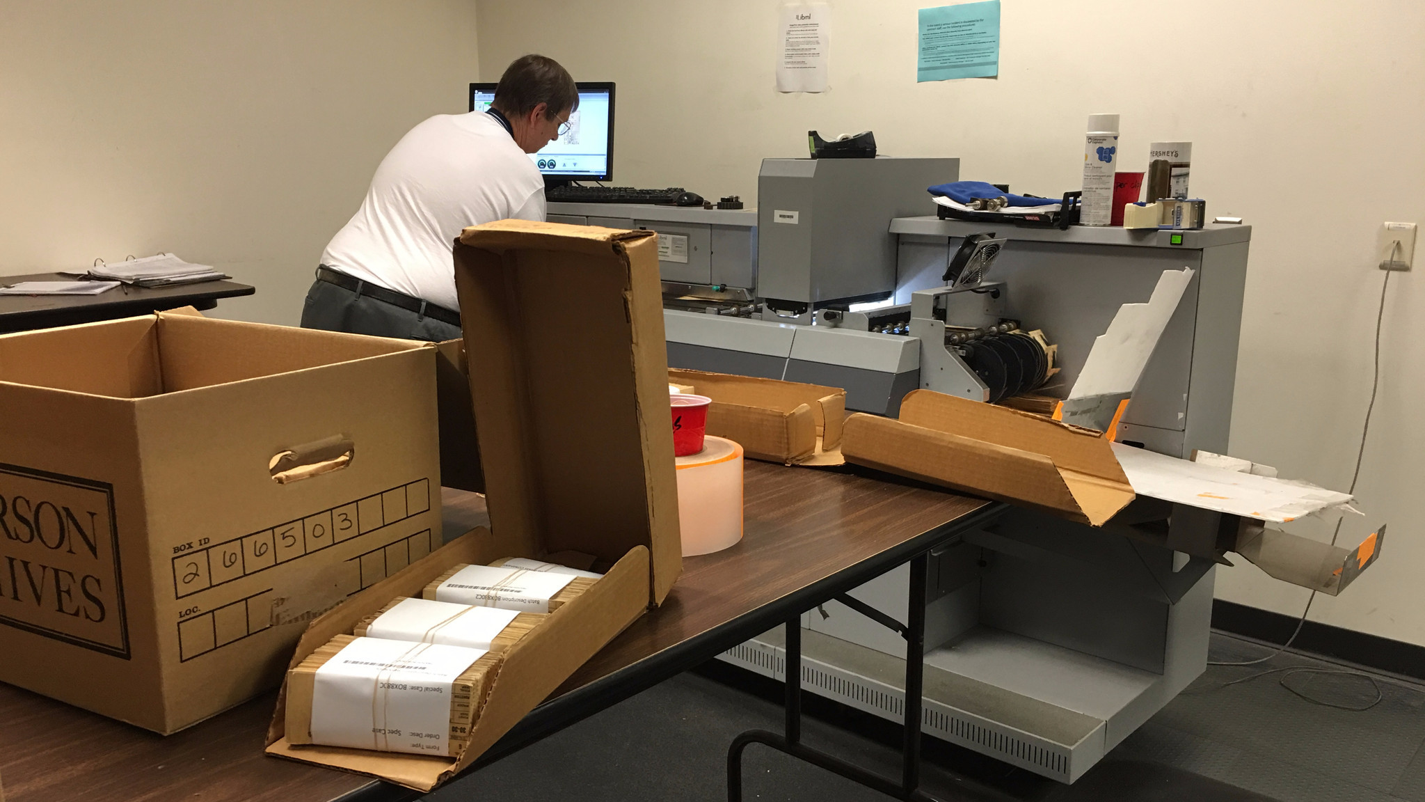 An analyst scans firearms records to be digitized. The ATF's national tracing center digitizes about 400,000 records a day.