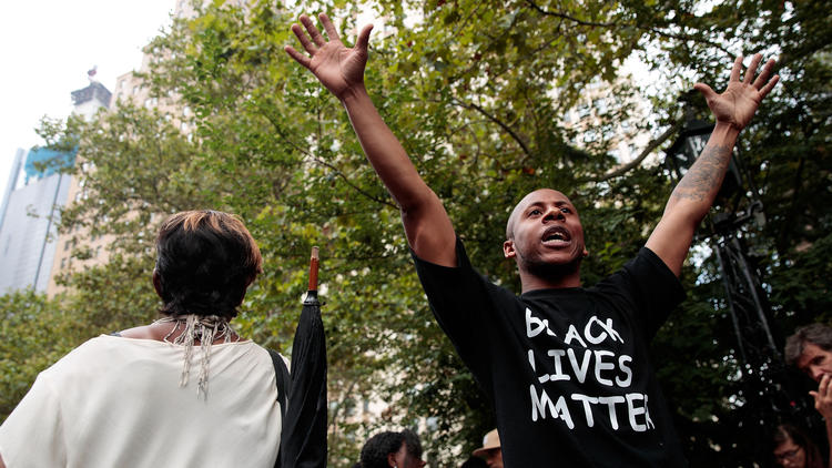 Protesters rally against police brutality near New York City Hall. (Drew Angerer / AFP/Getty Images)
