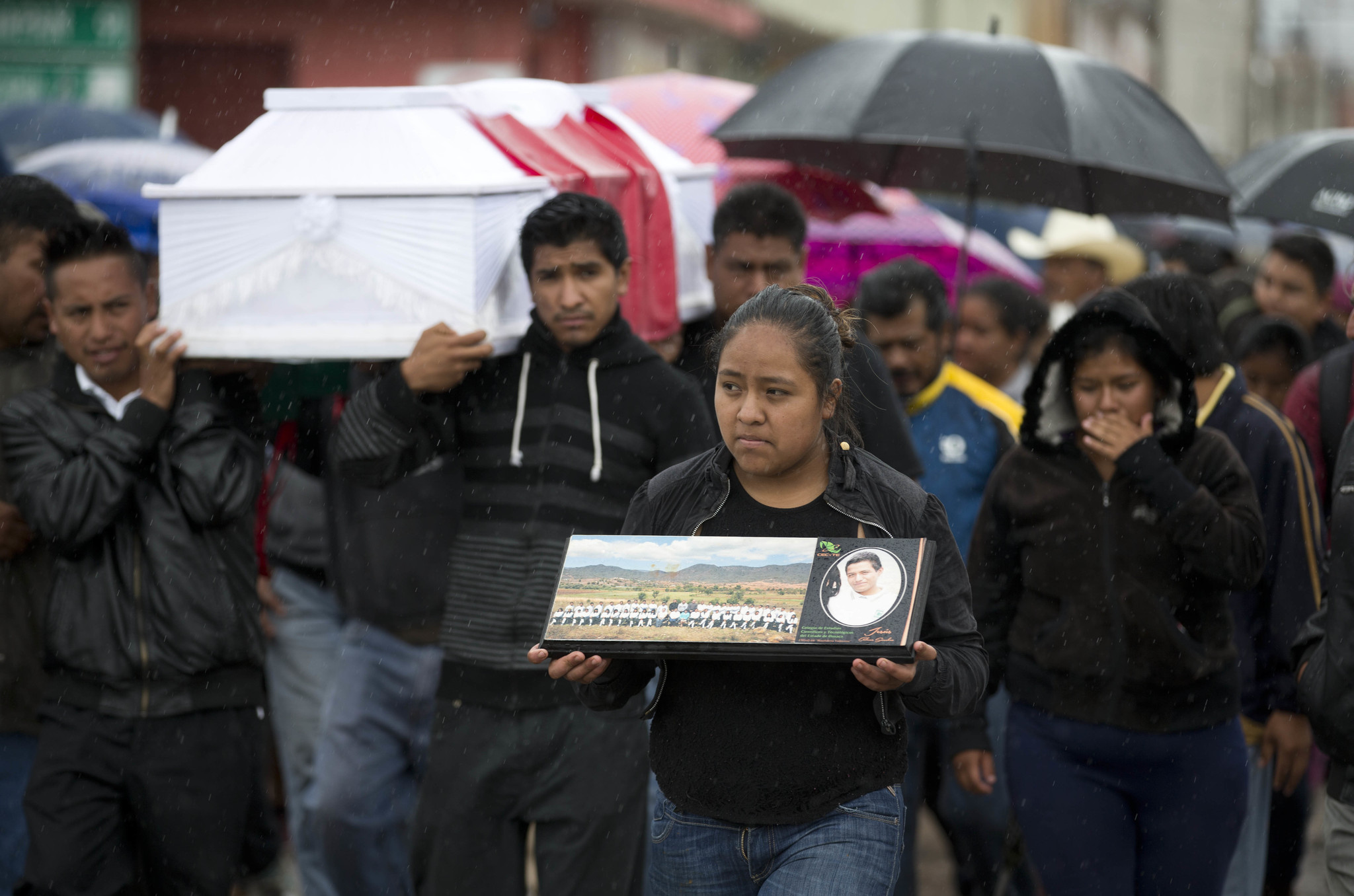 Mourners carry the coffin of Jesus Cadena Sanchez through Nochixtlan, where eight people died in June during a confrontation between police and protesting teachers who blockaded a roadway.